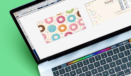 Laptop displaying donut business card design