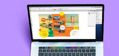Laptop with tri fold leaflet design on screen
